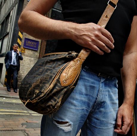 A man with a man bag
