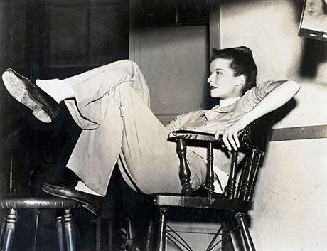 Katherine Hepburn relaxes between scenes of the making of a new Metro-Goldwyn-Mayer film. 1947.